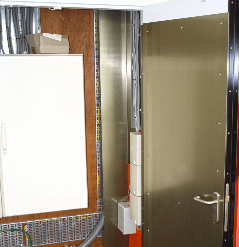 Example of a Mu-ferro cable trunking in a meter box. The doors are also equipped with a mu-ferro magnetic shielding